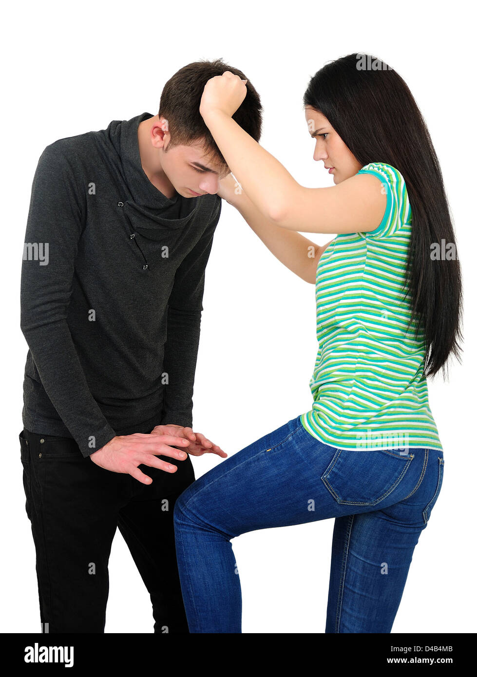 Isolated young casual couple argue - Stock Image