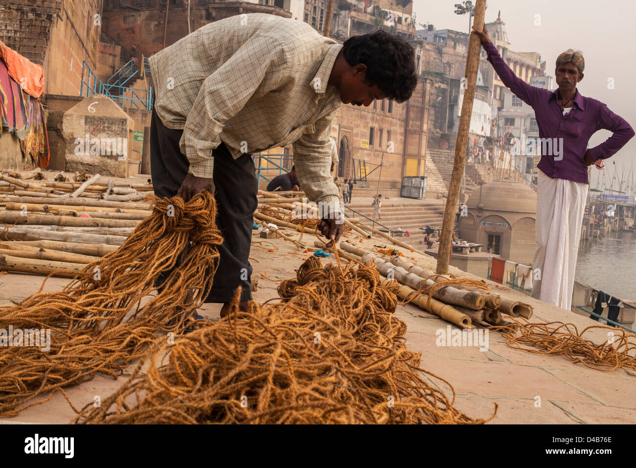 labourers on the ghats of Varanasi, India - Stock Image