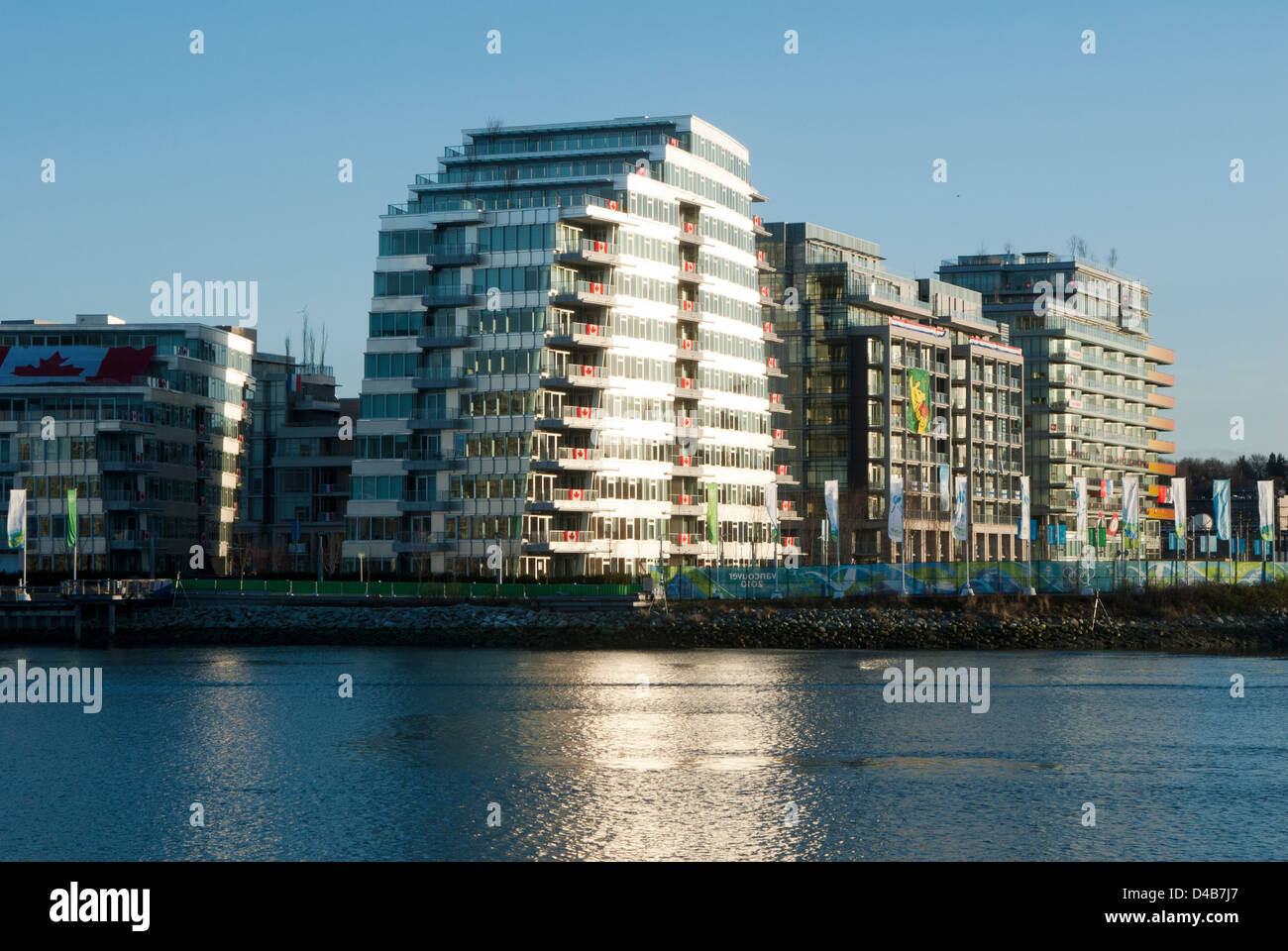 Condos at the Athlete's Village in Vancouver during the 2010 Olympics with flags are draped from balconies indicating - Stock Image