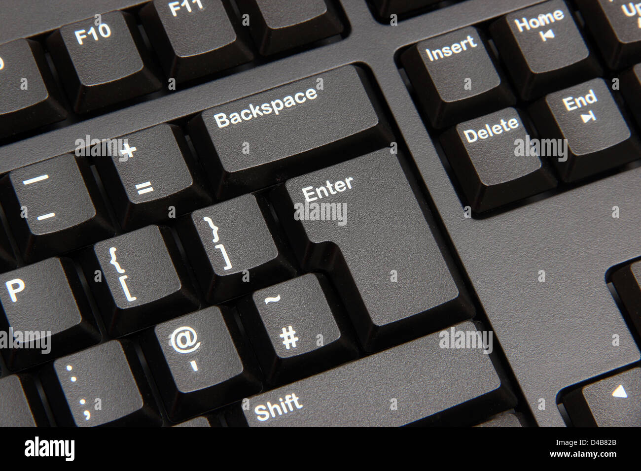 Close up of Enter button on computer keyboard - Stock Image