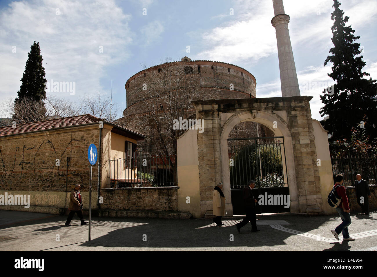 Thessaloniki, Greece. 11th March, 2013. People walks outside of the Rotunda, a 4th-century monument in Thessaloniki. - Stock Image