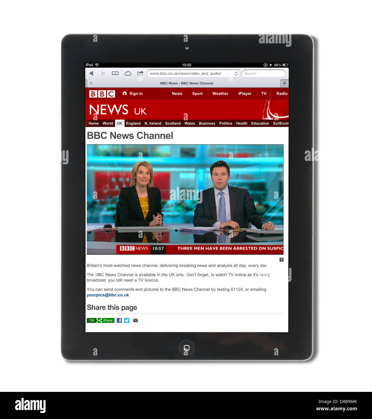 Watching live news on the BBC News channel website on an Apple iPad 4 - Stock Image
