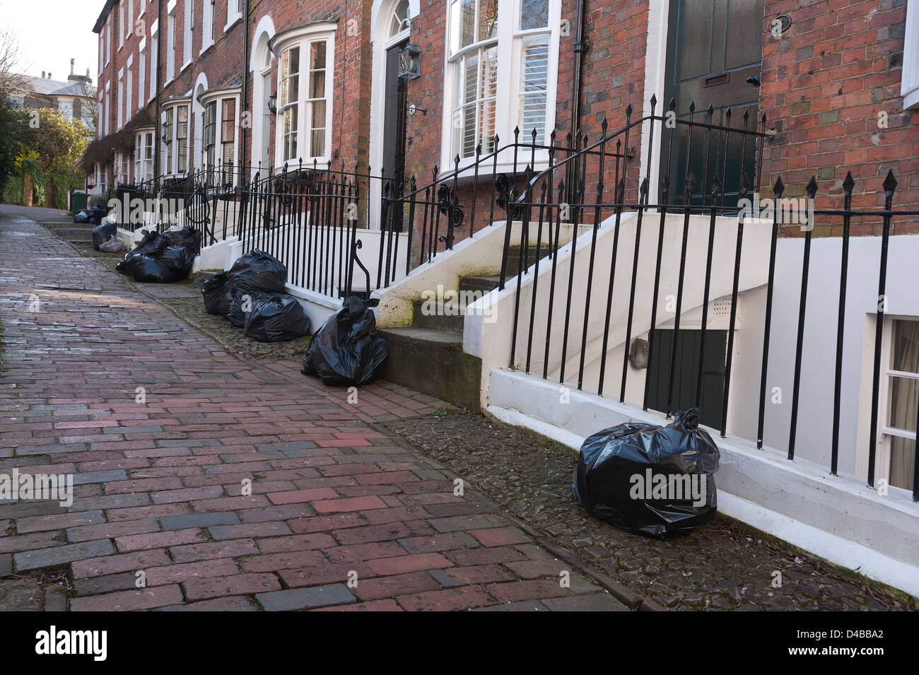 Paved street alley way with no vehicle access to well maintained Victorian houses making refuse collection difficult Stock Photo