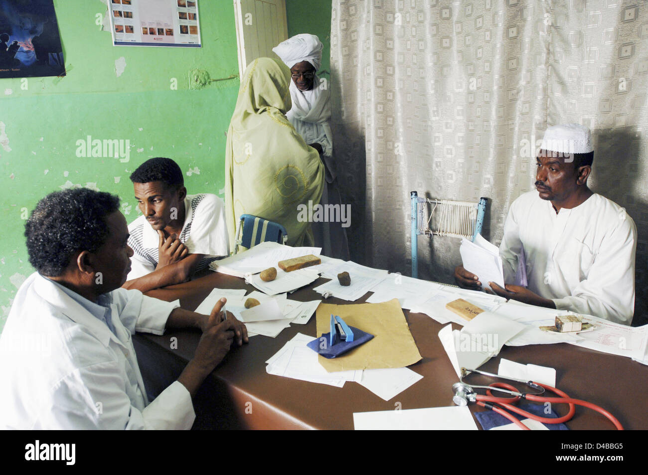 Patients waiting for nurse or doctor in outpatients clinic at Sudanese hospital - Stock Image