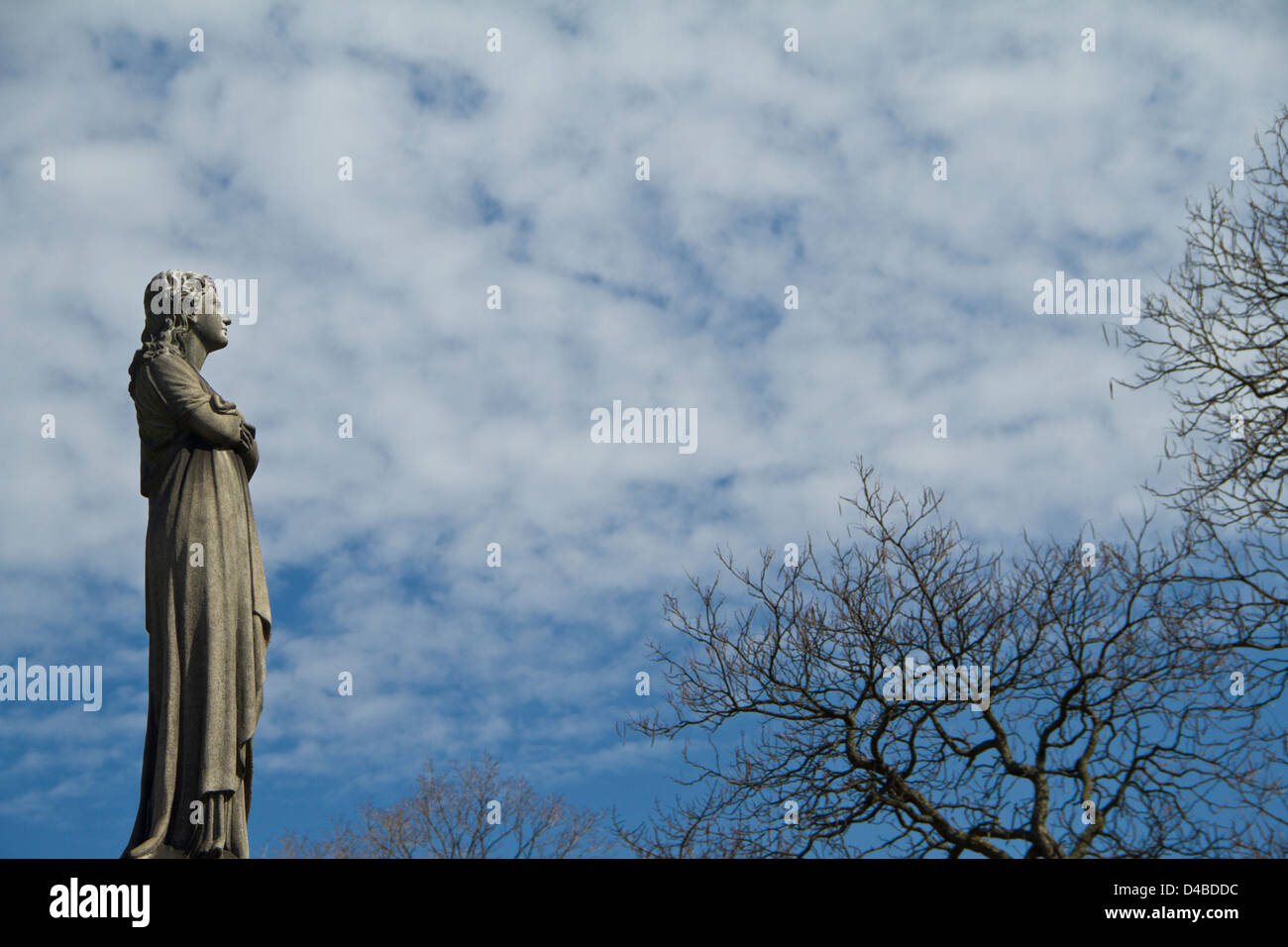 Female Statue in Graveyard - Stock Image