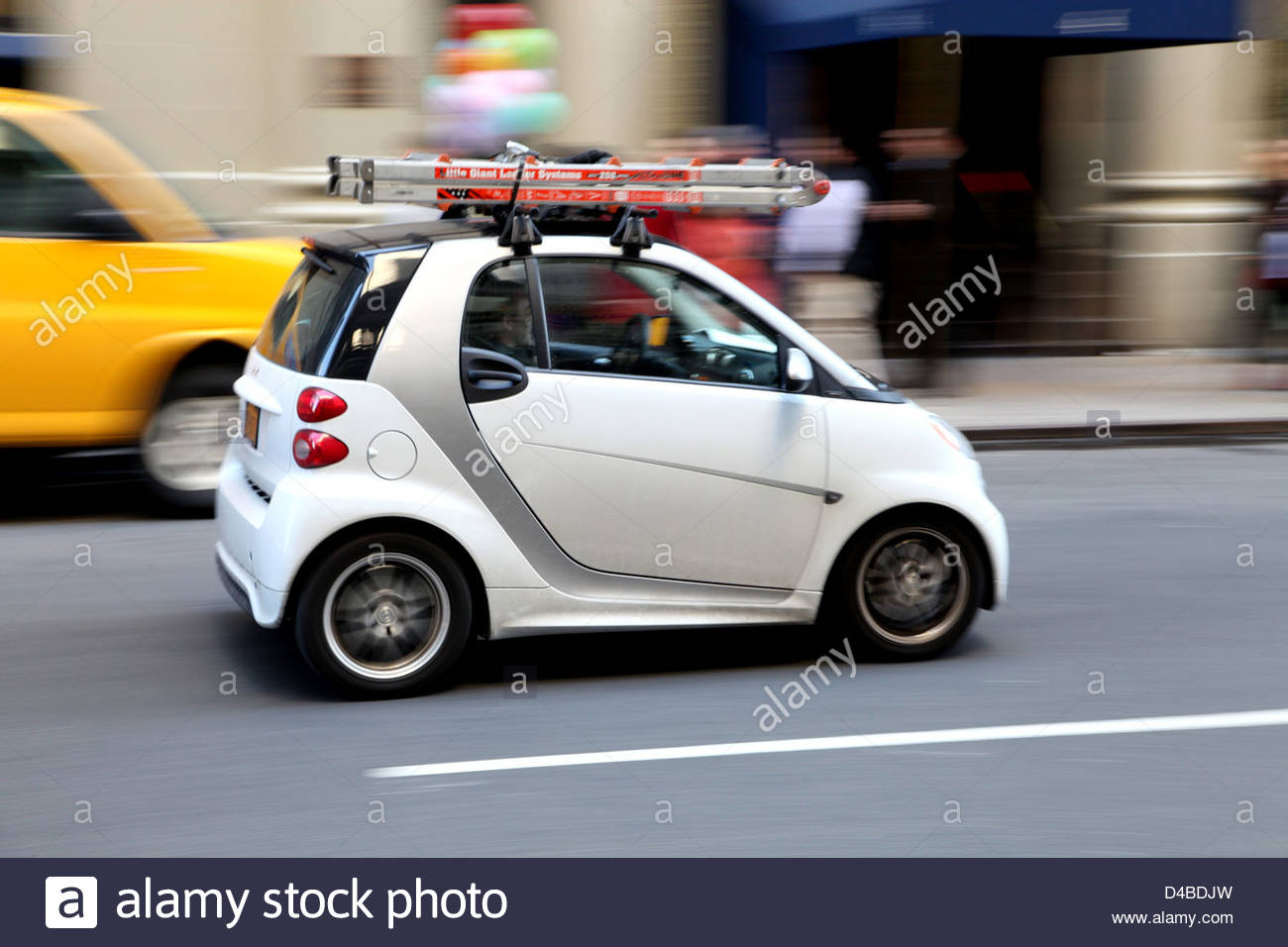 a white smart car with roof rack and step ladder stock photo 54341921 alamy. Black Bedroom Furniture Sets. Home Design Ideas