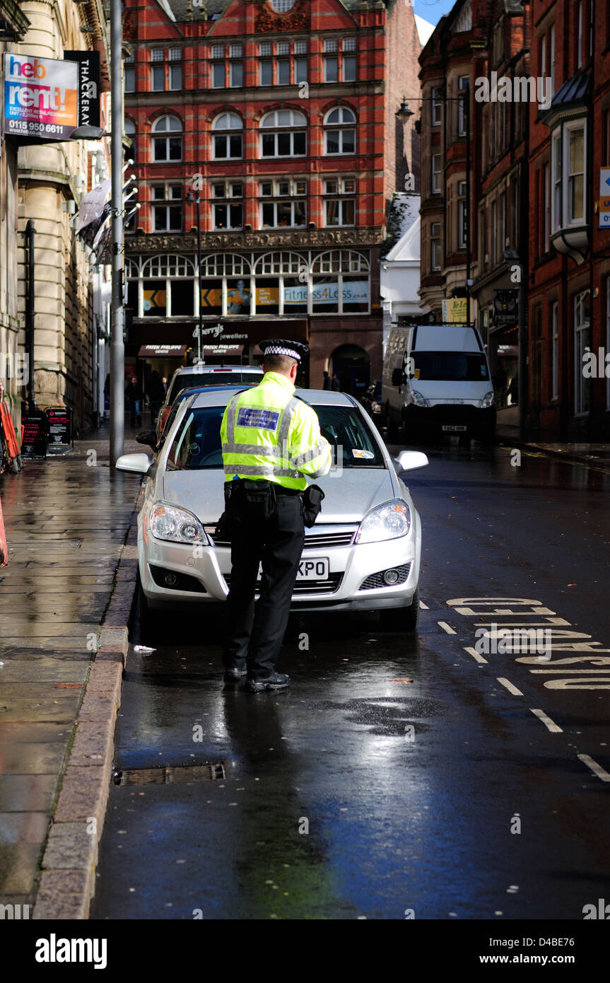 Penalty Charge Notice.Civil Enforcement Officer Issues Ticket for Disabled Driver . - Stock Image