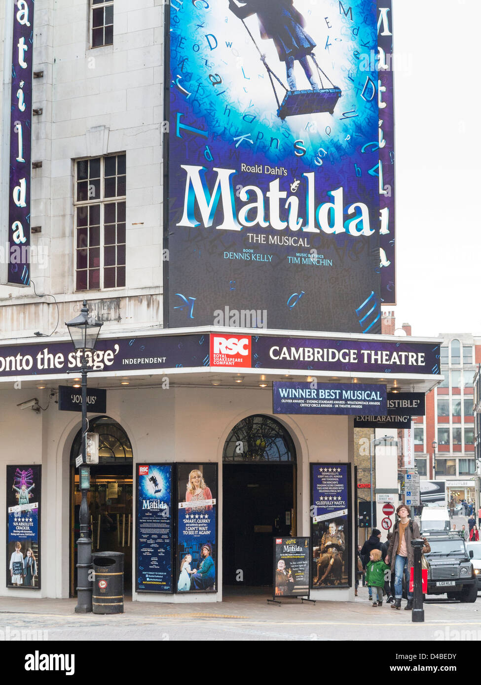 Cambridge Theatre with signs for the musical Matilda in London, England - Stock Image
