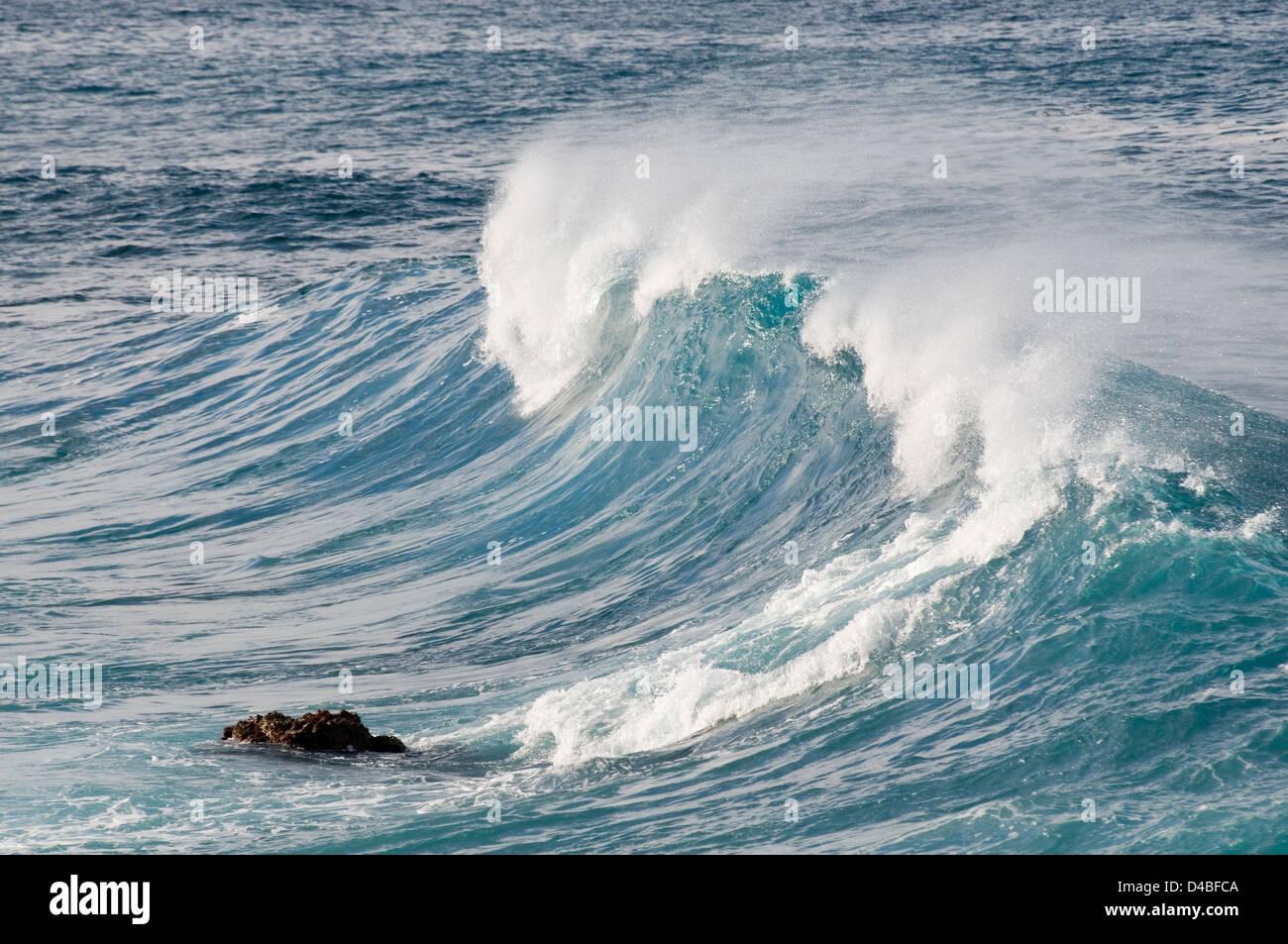wave waves breaking breakers sea seas rough water motion energy white horses spray - Stock Image