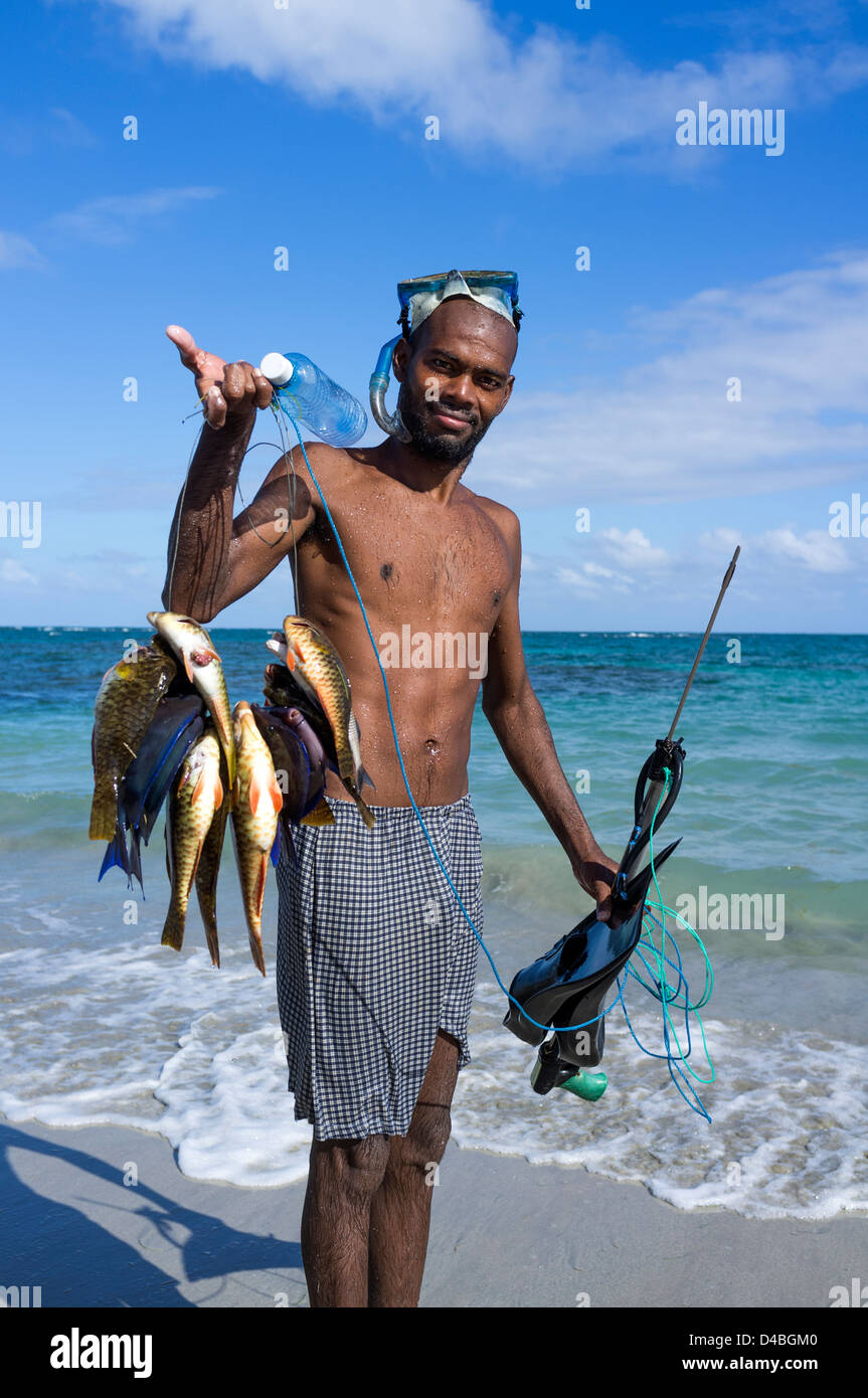 Local fisherman, using snorkel and fishing gun to catch fish, Vieux Fort, St Lucia - Stock Image
