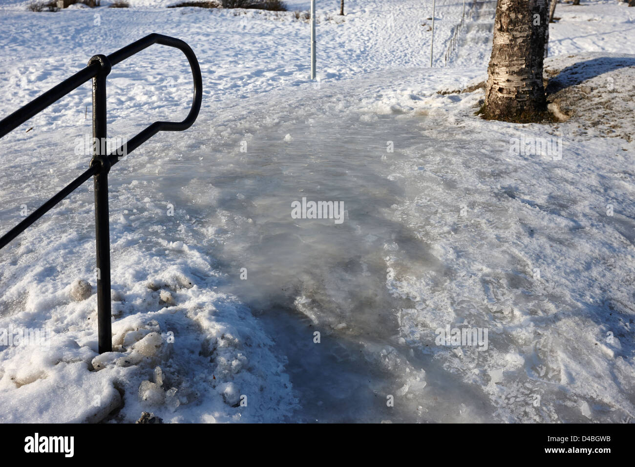 thick ice forming at the top of steps on a hill Tromso troms Norway europe - Stock Image