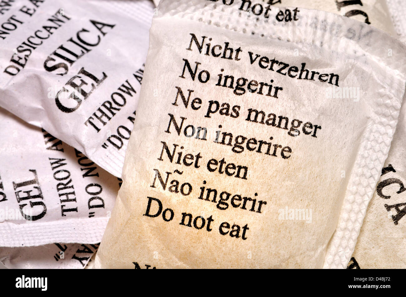 Multilingual instructions on sachet of silica gel. 'Do Not Eat in German, Spanish, French, Italian, Dutch, Portuguese, Stock Photo