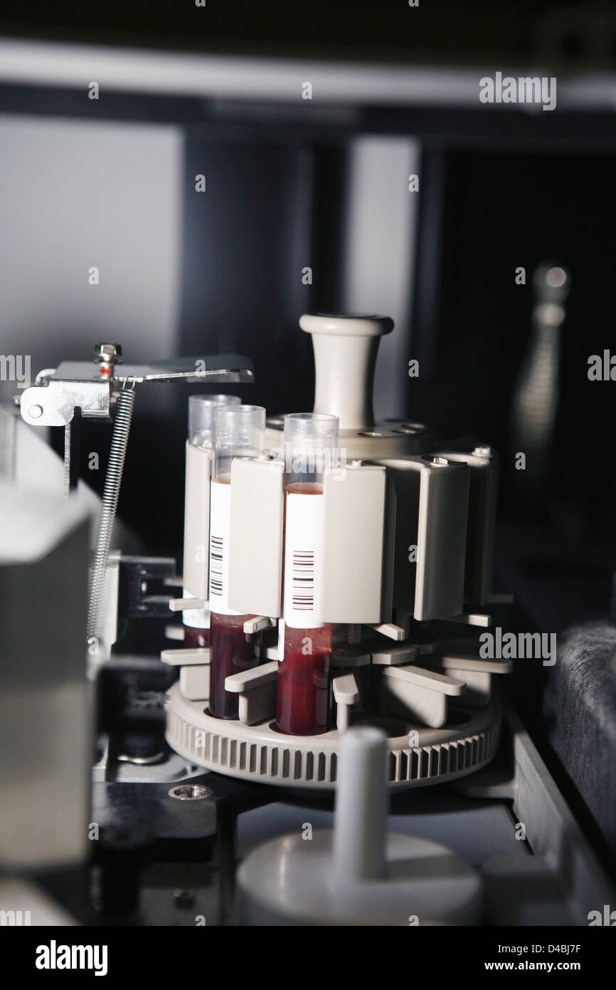 Centrifuge used to separate blood samples - Stock Image