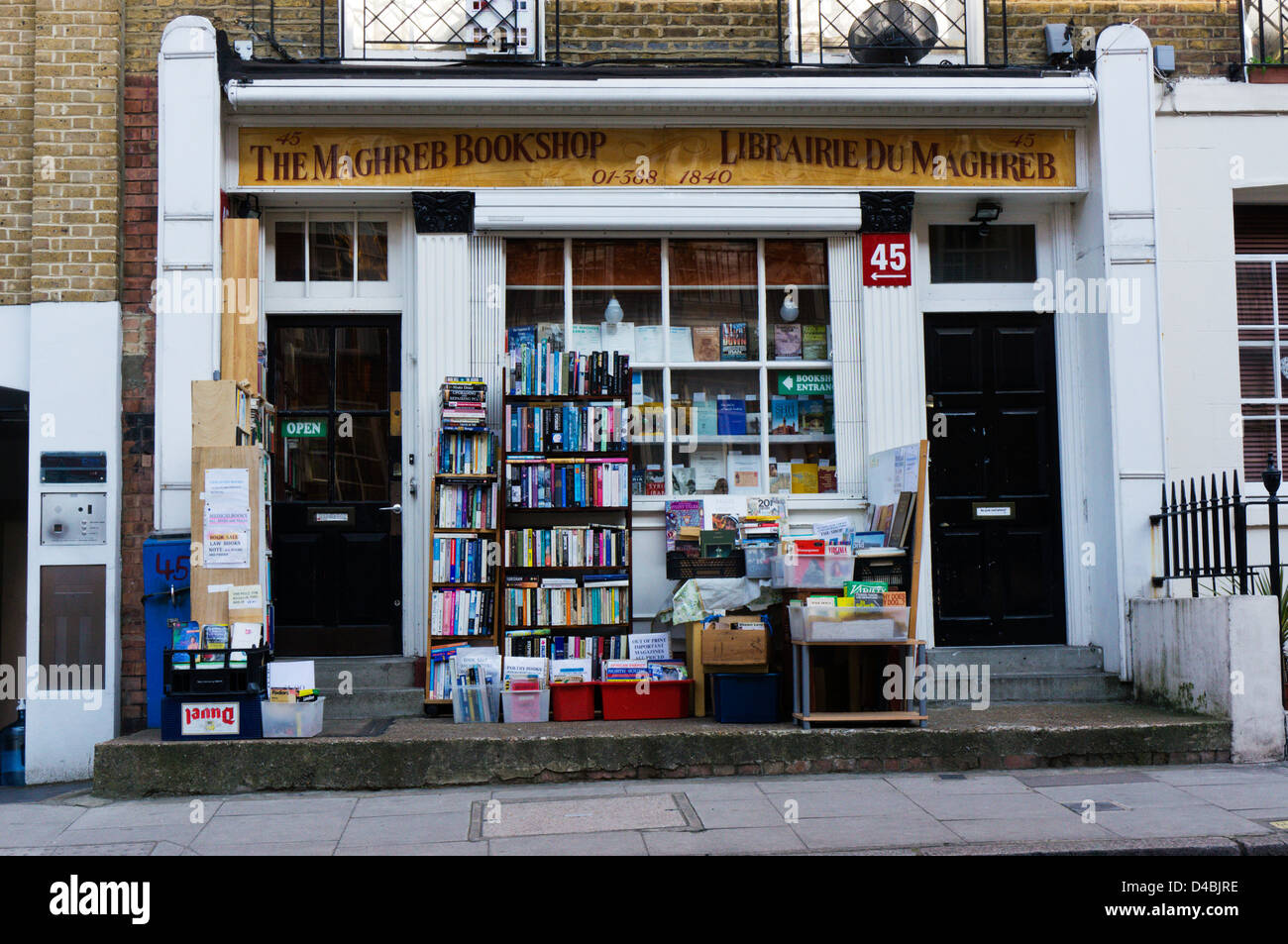 Books stacked on shelves outside The Maghreb Bookshop in Burton Street, Bloomsbury, London. - Stock Image
