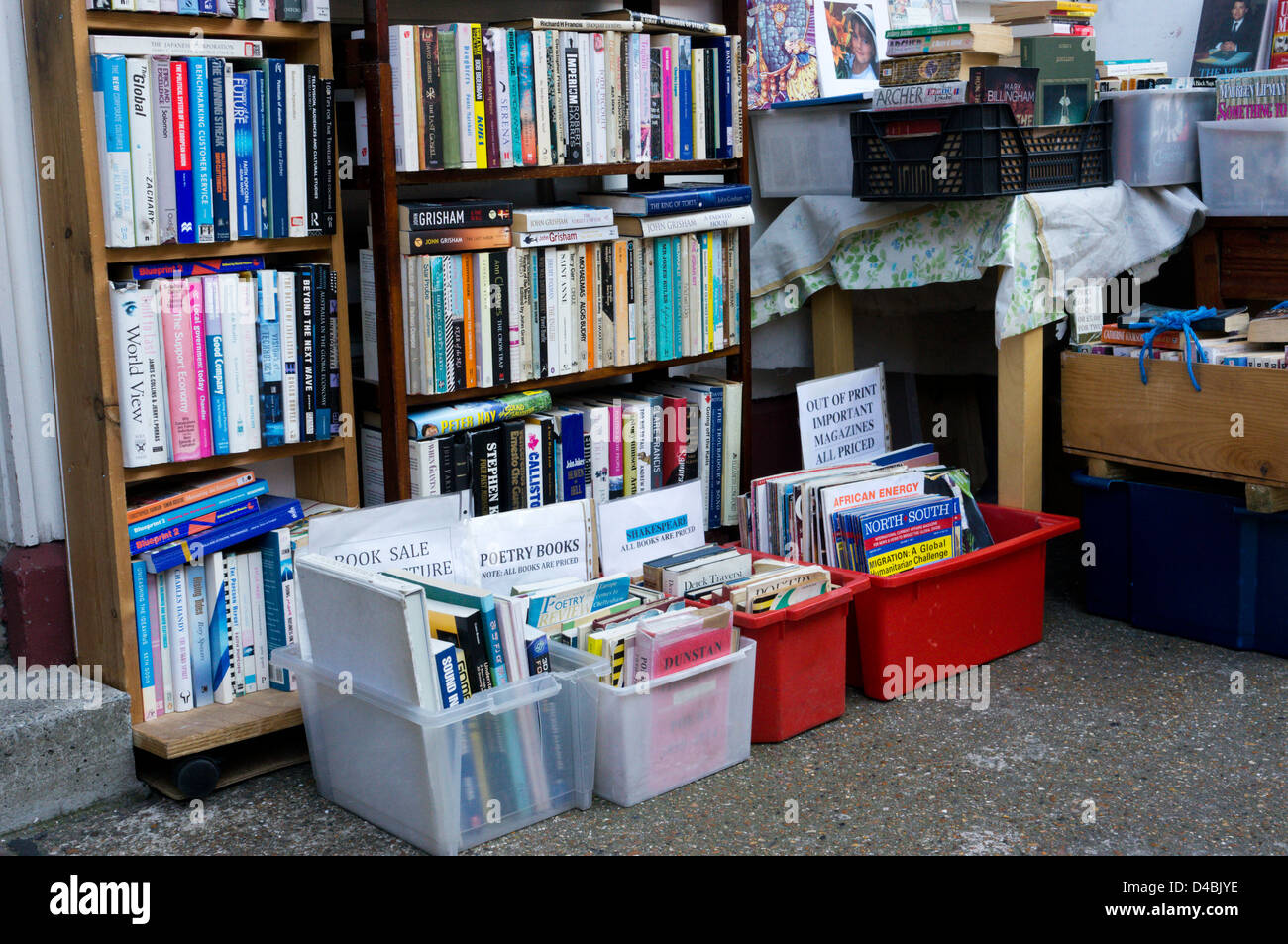 Books stacked on shelves and in boxes outside a secondhand bookshop. - Stock Image