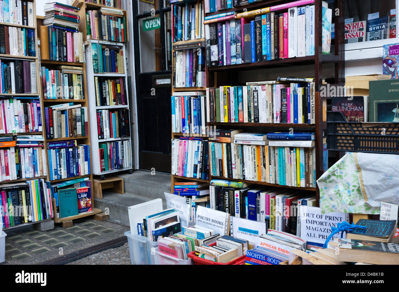 Books stacked on shelves outside a secondhand bookshop. Stock Photo
