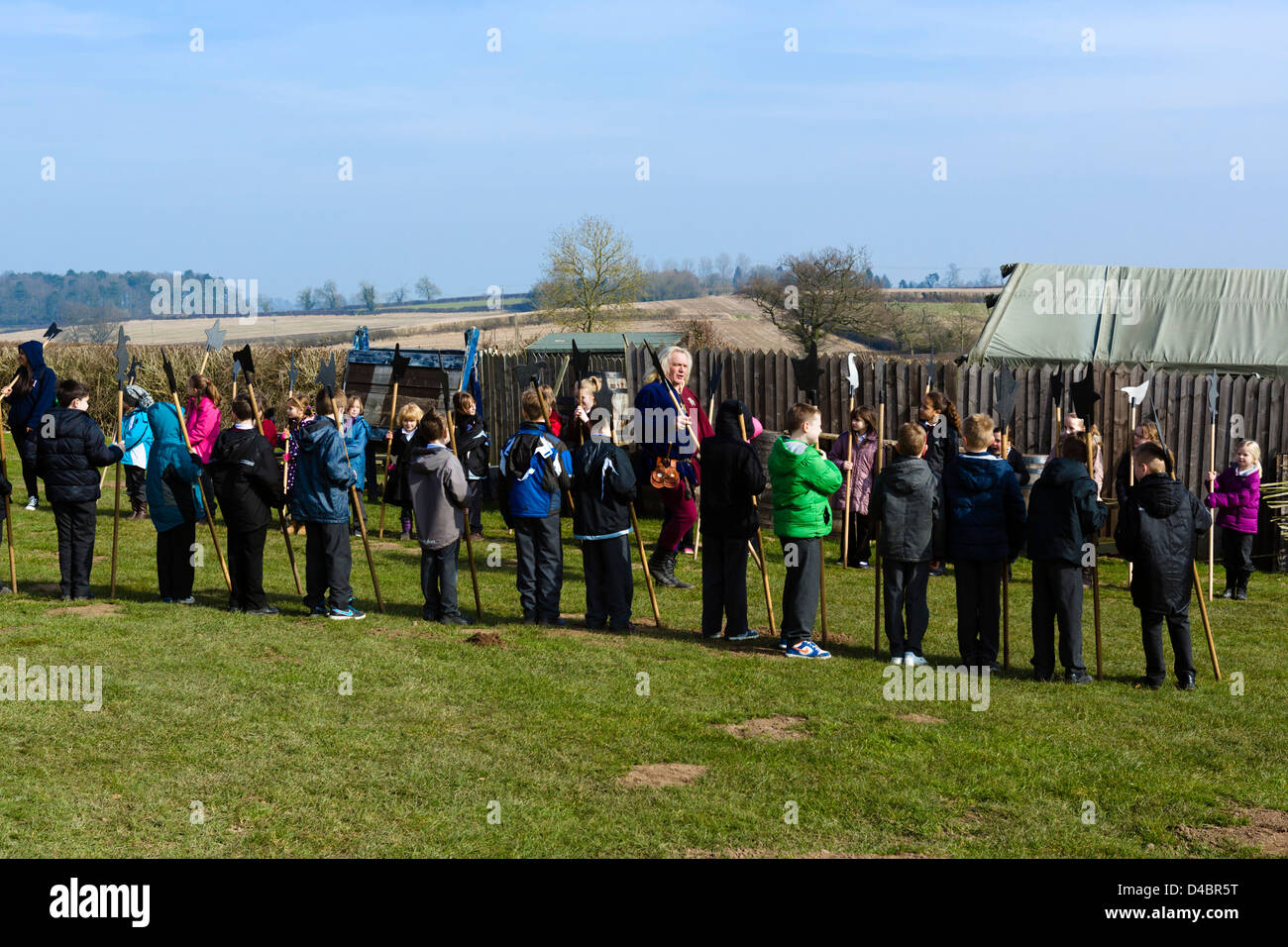 Party of schoolchildren using historic weapons at the Heritage Centre, Bosworth Field, Leicestershire, East Midlands, - Stock Image