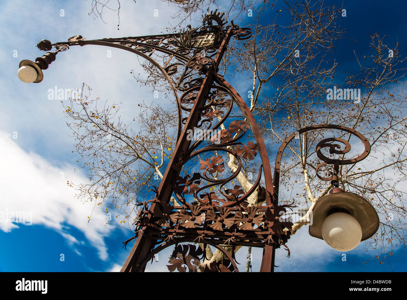 Modernist style street lamp in Passeig de Gracia, Barcelona, Catalonia, Spain - Stock Image