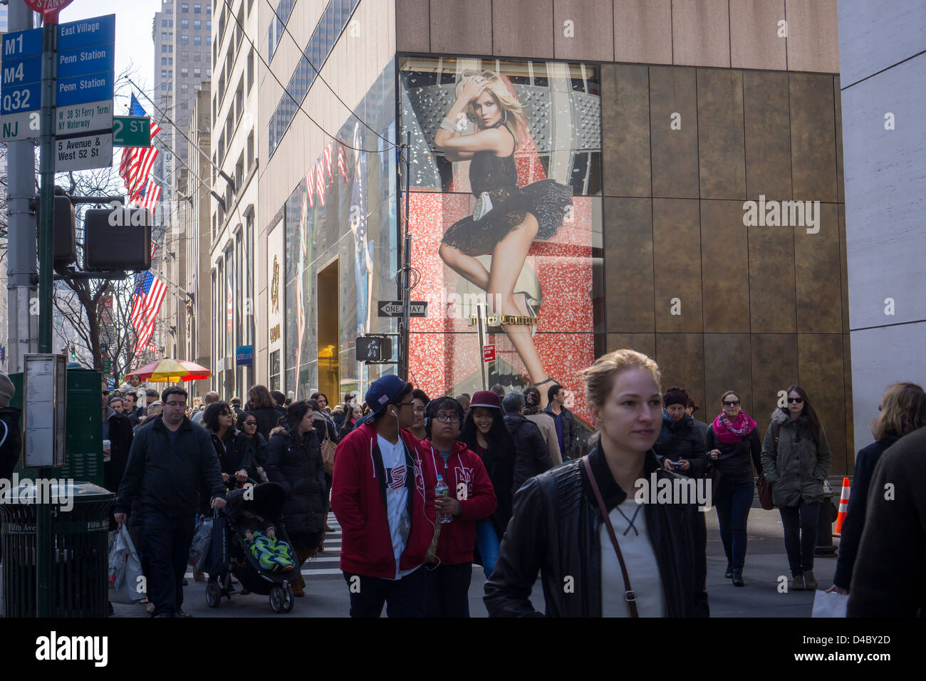 Shoppers pass a Juicy Couture store in the midtown Manhattan neighborhood of New York - Stock Image