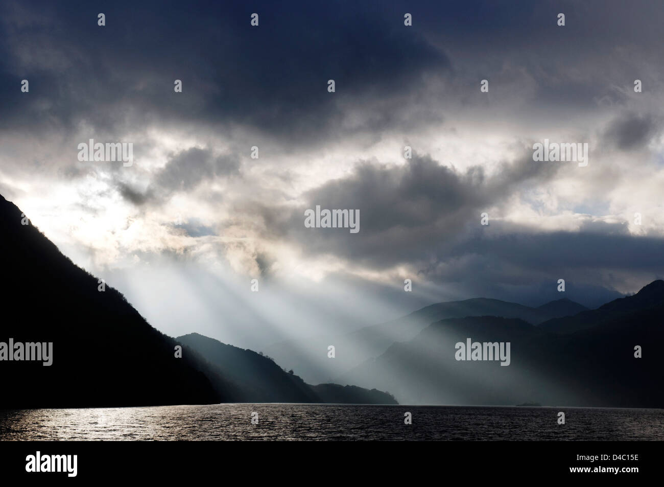 Dramatic storm lighting and sunbeams over Ullswater in the Lake District Stock Photo
