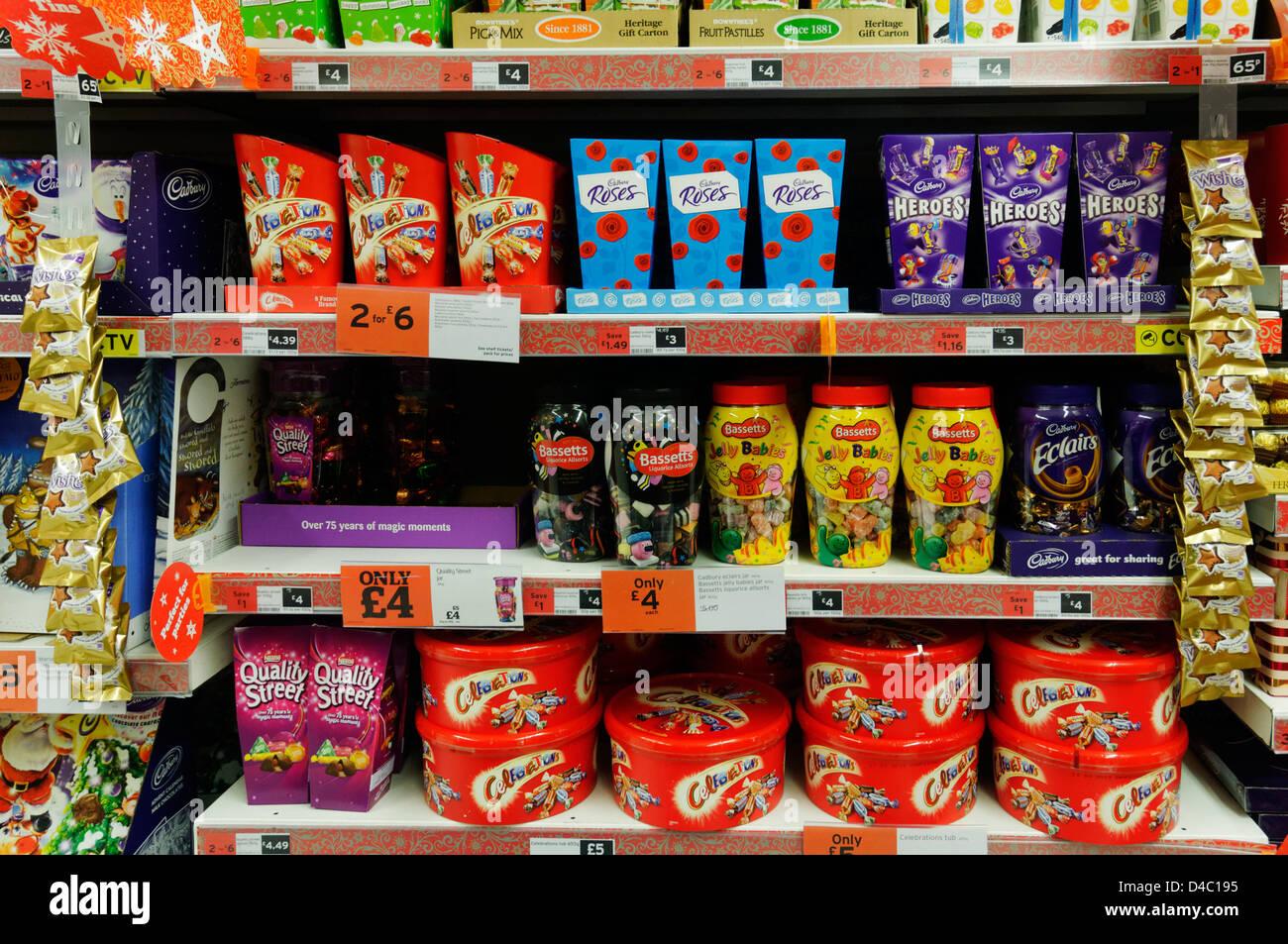Boxes of chocolates on Sainsbury`s supermarket shelves at Christmas - Stock Image