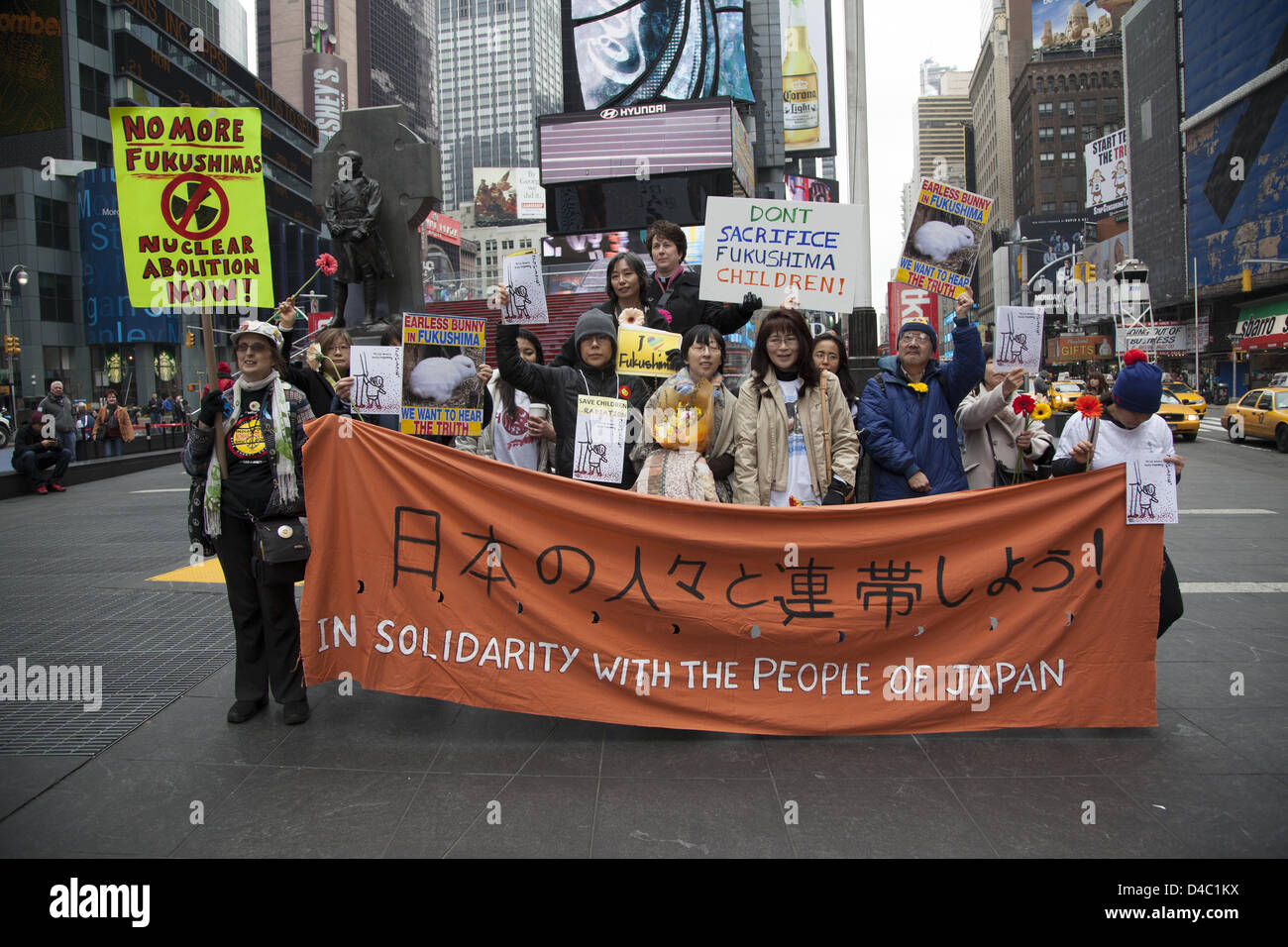 New York, USA. 10th March 2013. 2nd anniversary commemoration march, not to forget the children of Fukushima and Stock Photo