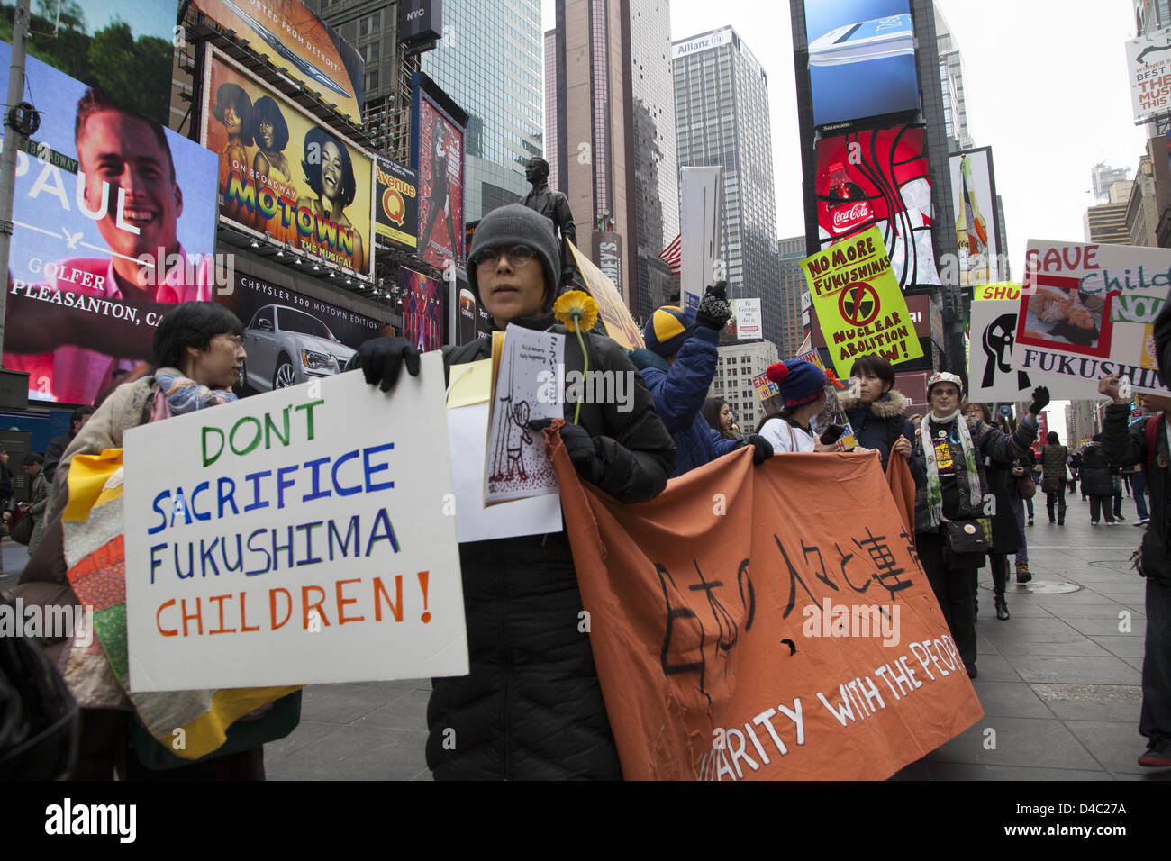 New York, USA. 10th March 2013. 2nd anniversary commemoration march, not to forget the children of Fukushima and - Stock Image