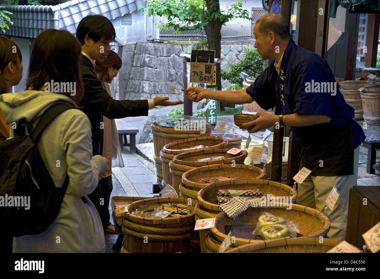 Visitors to rural countryside village of Ohara, Kyoto stop by a local otsukemono (pickled vegetables) shop for a - Stock Image