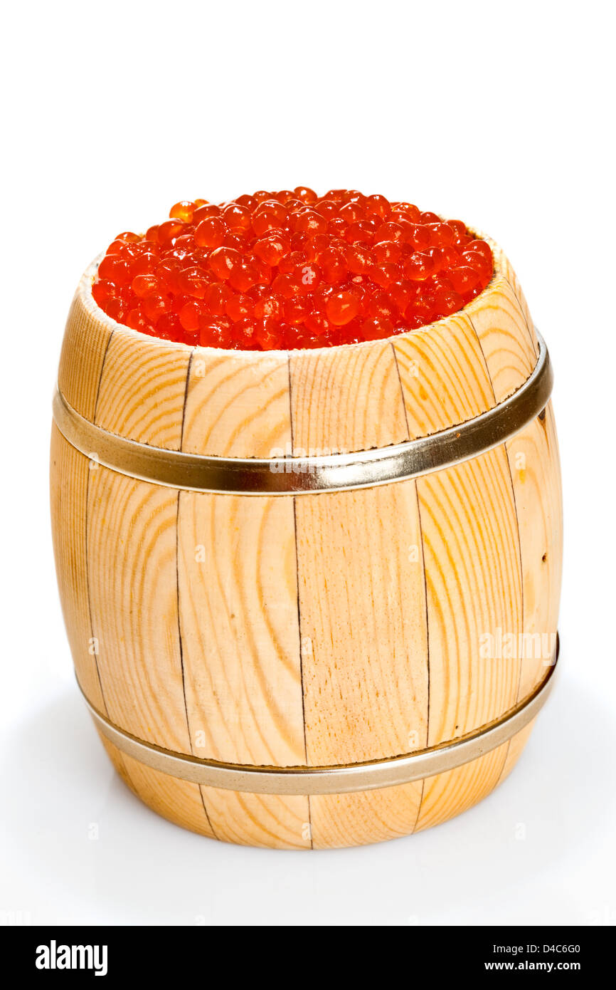 Russian red caviar in small barrel on the white - Stock Image
