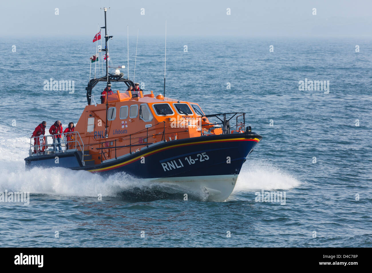 RNLI lifeboat crew at sea in new Tamar class vessel 'Kiwi' in Moelfre, Isle of Anglesey, North Wales, UK, - Stock Image