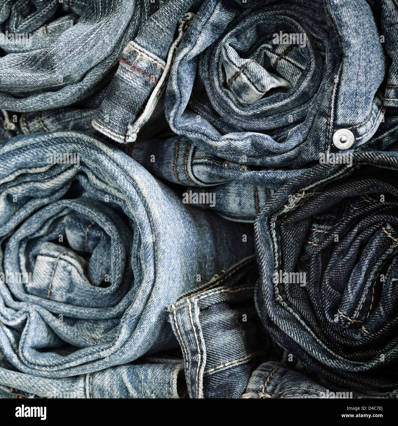 Blue Jeans background, selective focus on nearest - Stock Image