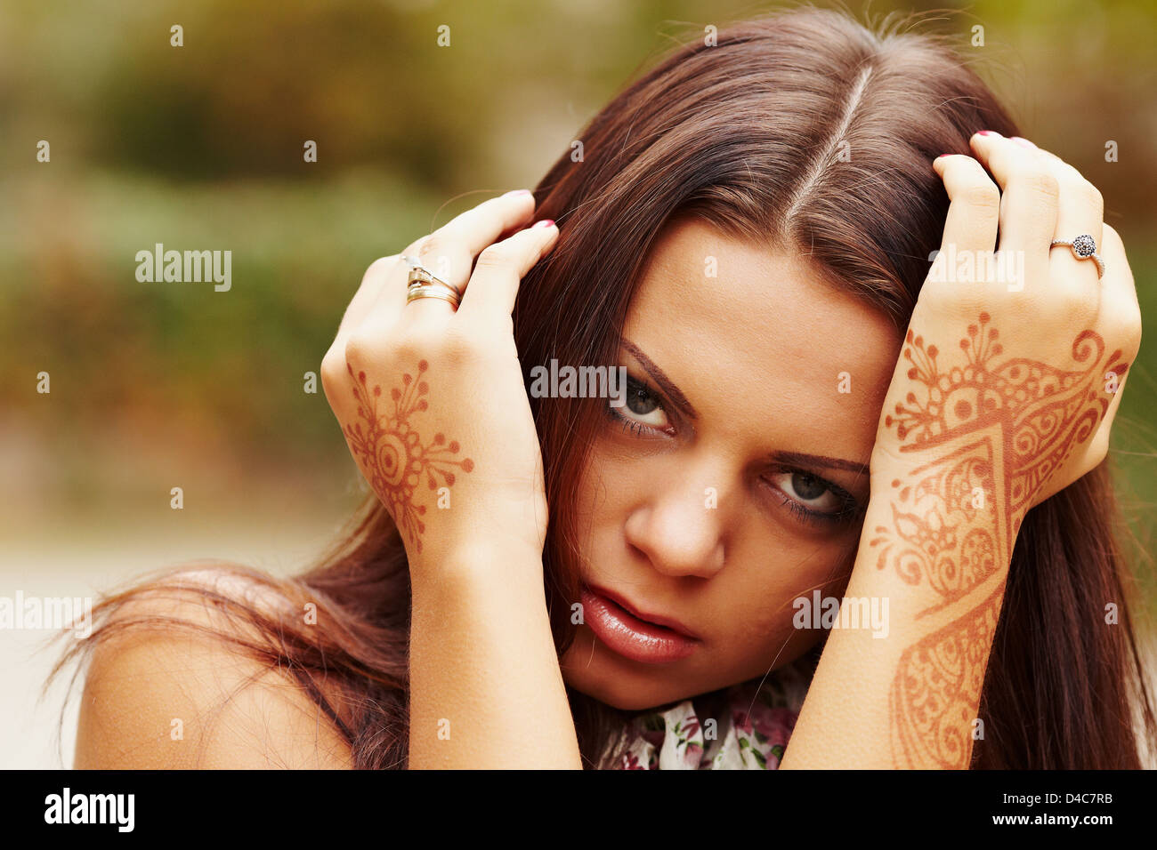 Beautiful girl painted Mehandi - Stock Image