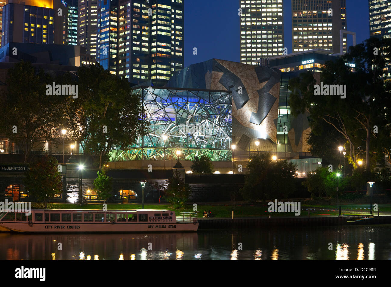 View across Yarra River to architecture of Federation Square at night. Melbourne, Victoria, Australia - Stock Image