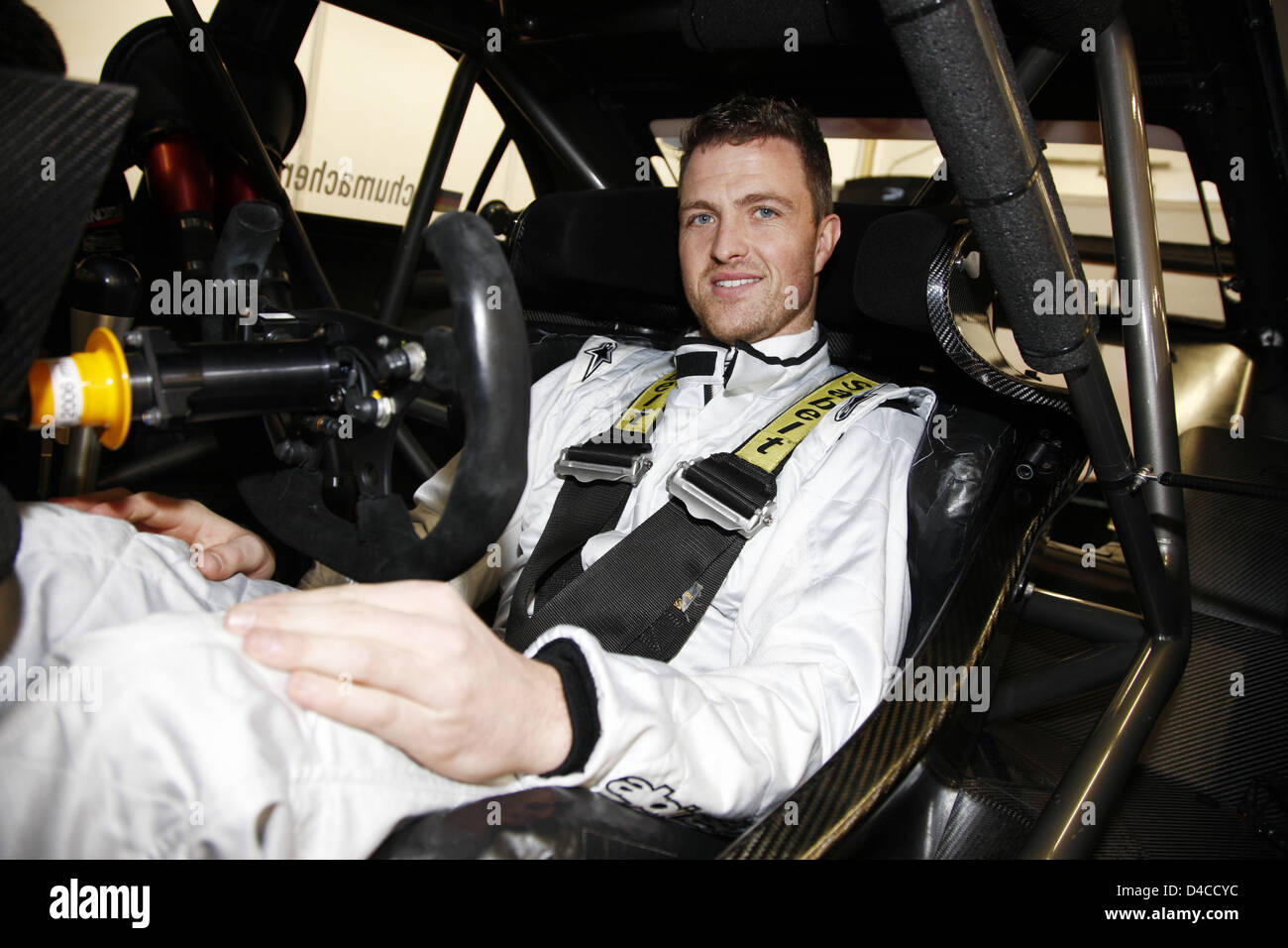 Ralf Schumacher sits behind the steering wheel of a 2008 DTM-Mercedes at the race track in Estoril, Portugal, 16 - Stock Image