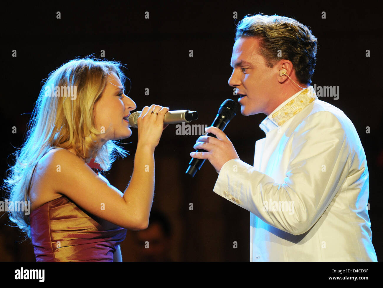 Folksy music singers Stefan Mross and his wife Stefanie Hertel perform on stage at folksy music TV show 'Musikantenstadl' - Stock Image