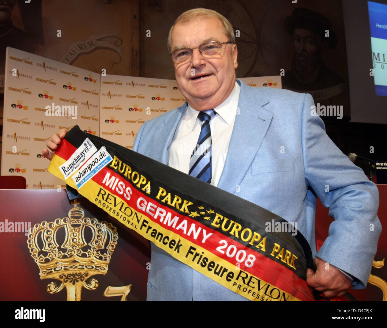 Horst Klemmer, organisor of the 'Miss Germany 2008' contest poses with a sash at Europa-Park in Rust, Germany, - Stock Image