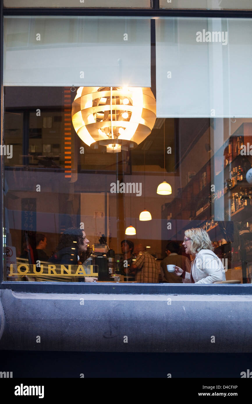 Women having morning coffee at Journal Cafe. Melbourne, Victoria, Australia - Stock Image