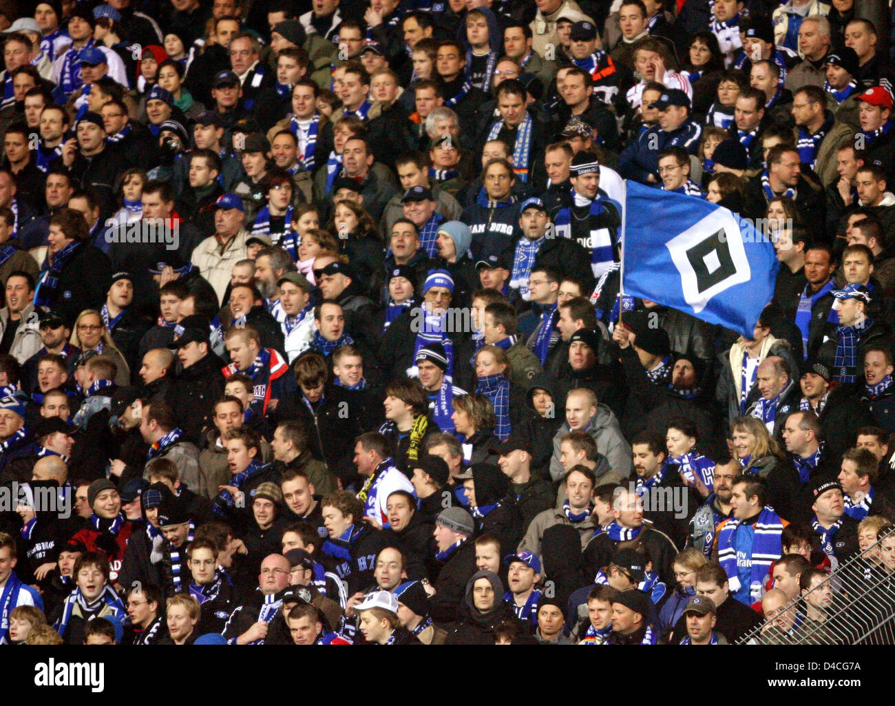 Fans of Hamburg cheer their team in the DFB Cup round of 16 match Rot-Weiss Essen v SV Hamburg at Georg Melches - Stock Image