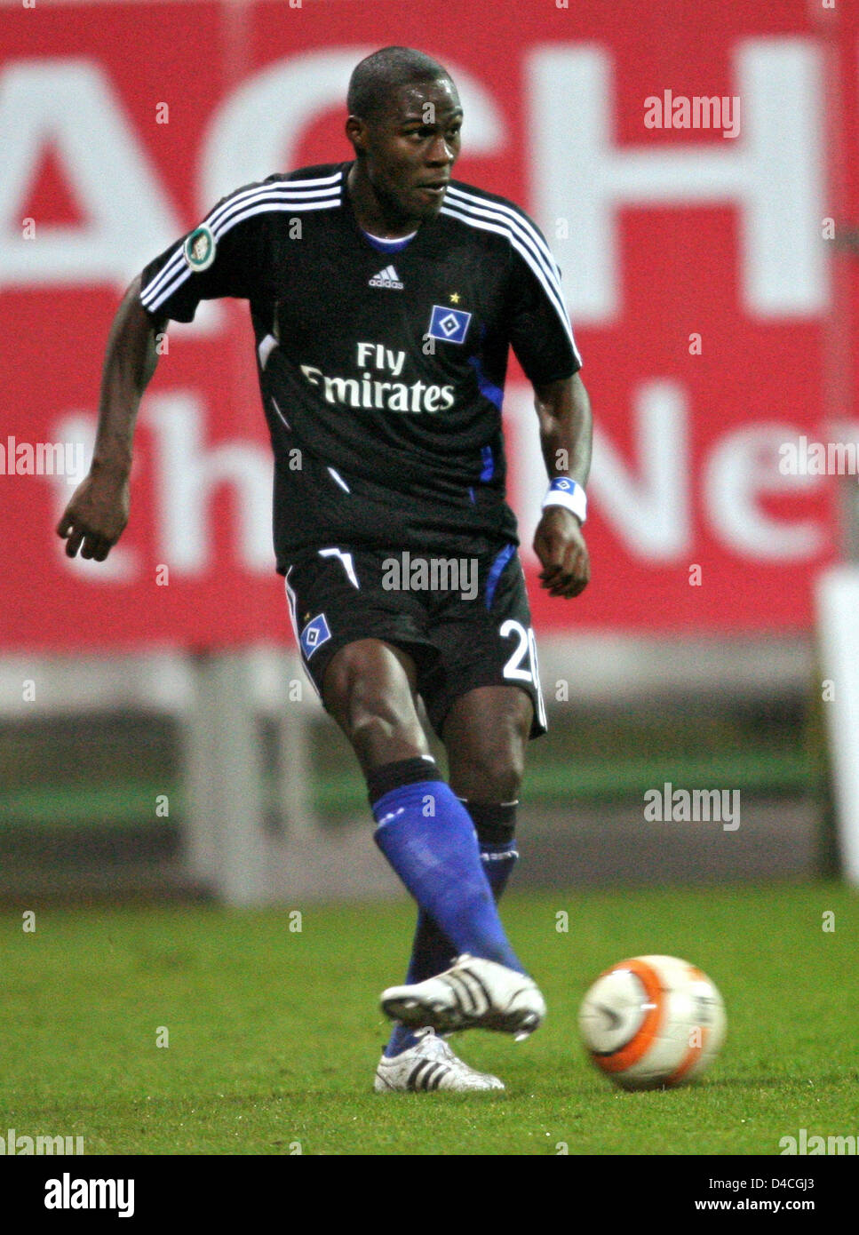 Guy Demel of Hamburg controls the ball during the DFB Cup round of 16 match Rot-Weiss Essen v SV Hamburg at Georg - Stock Image