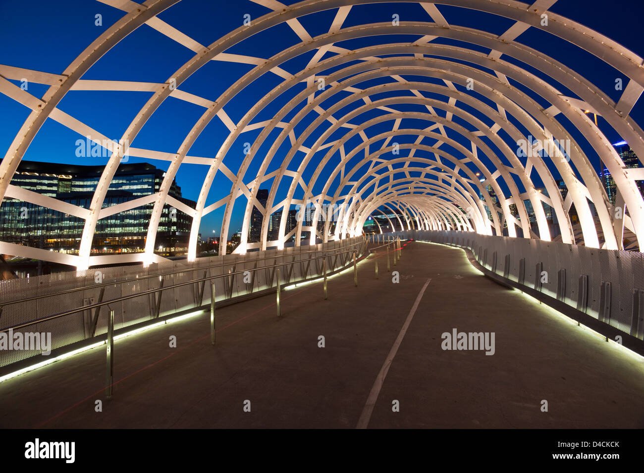 The Webb Bridge illuminated at twilight.  Melbourne, Victoria, Australia - Stock Image