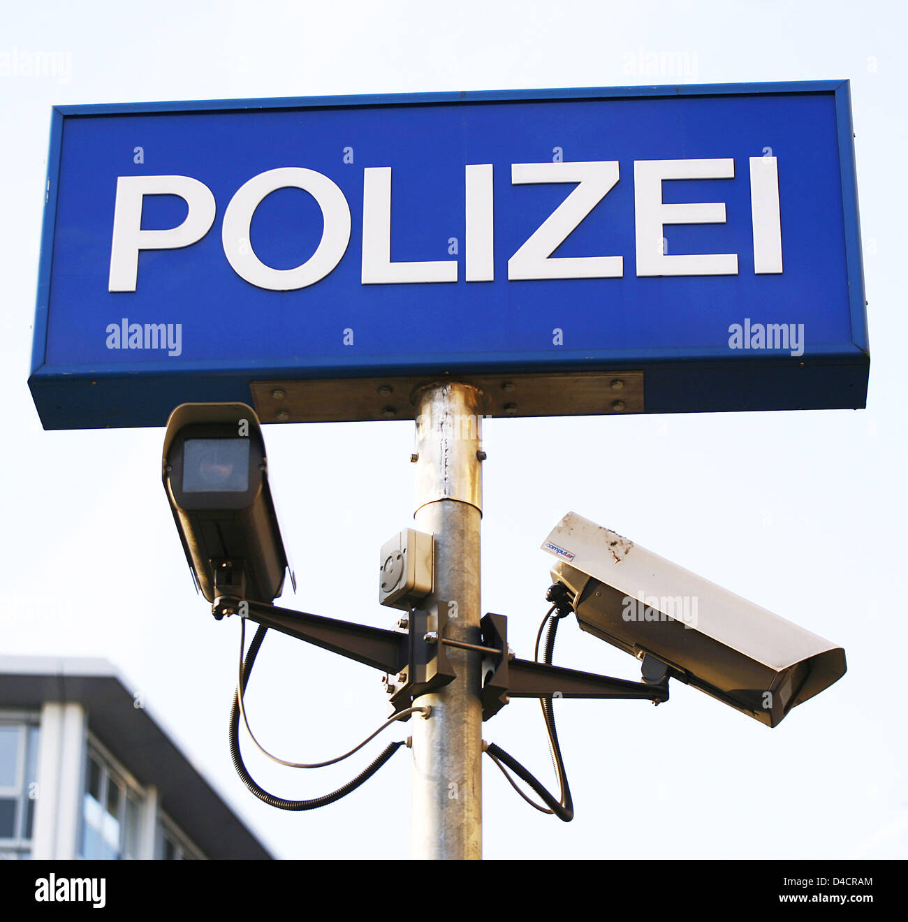 The picture shows surveillance cameras below a German police sign, in Frankfurt Main, Germany, 25 January 2008. - Stock Image
