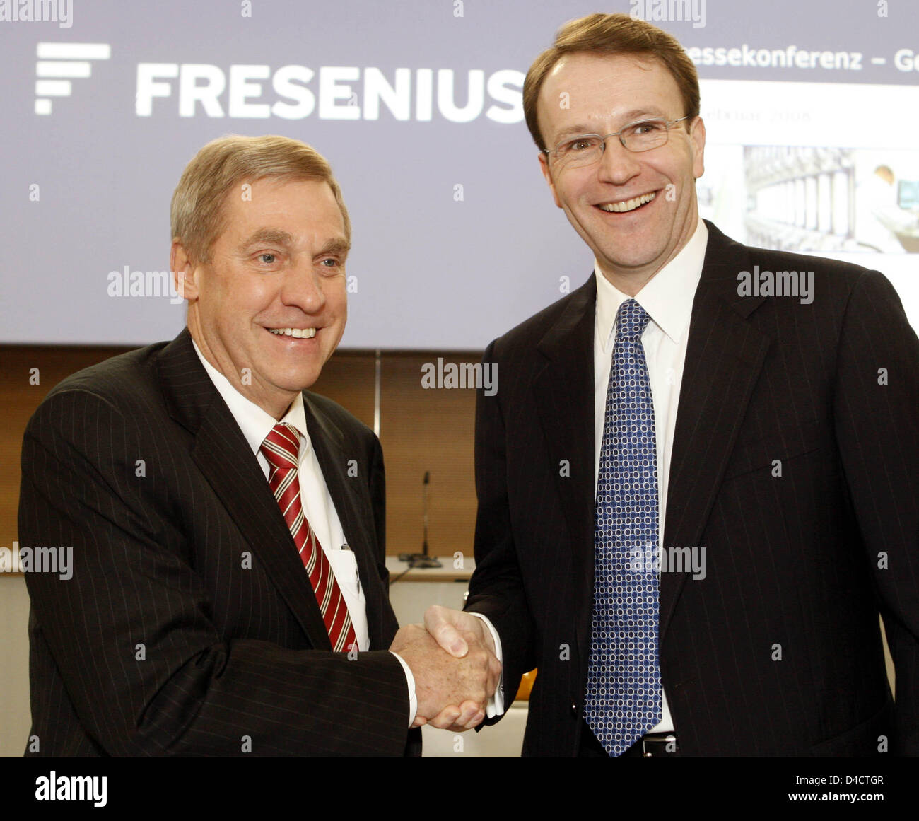 The CEO of Fresenius Medical Care, Ben Lipps (L) and the CEO of parent company Fresenius SE, Ulf Schneider are pictured - Stock Image