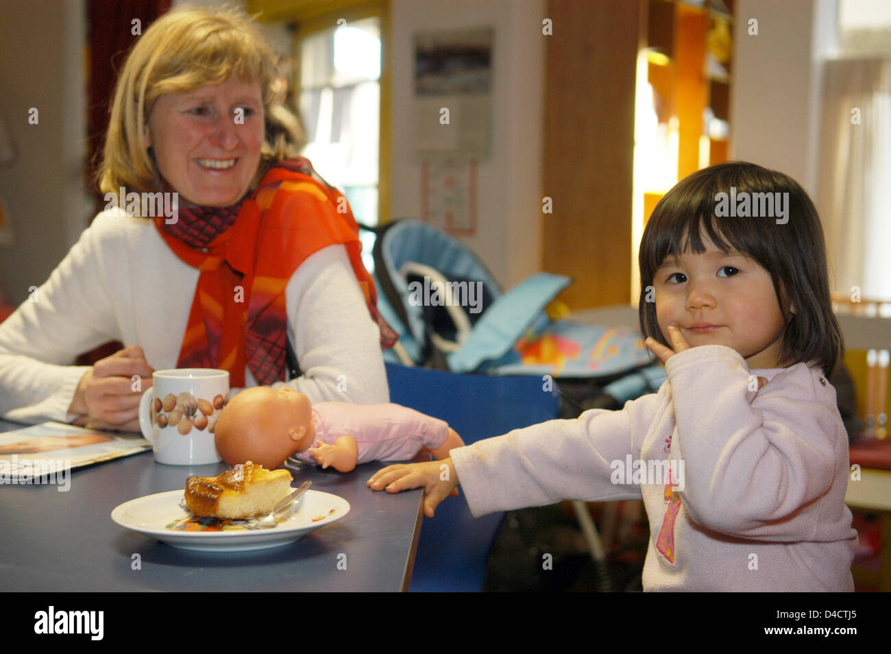 Susanne Moog and her German-Chinese daughter Melanie are pictured in the multigenerational house 'Unter den - Stock Image