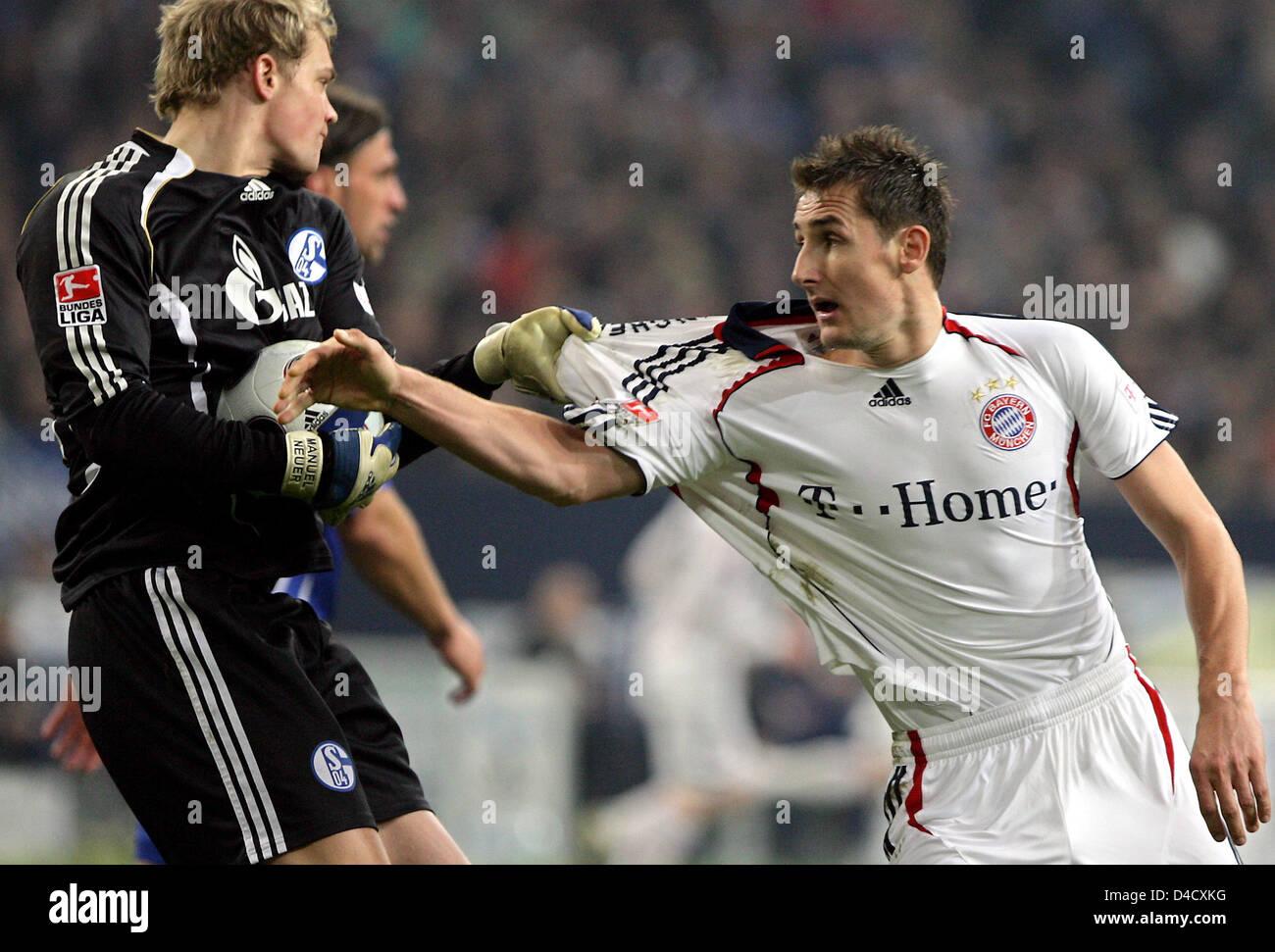 promo code 220bf 055fc Schalke's goalkeeper Manuel Neuer pulls the jersey of ...