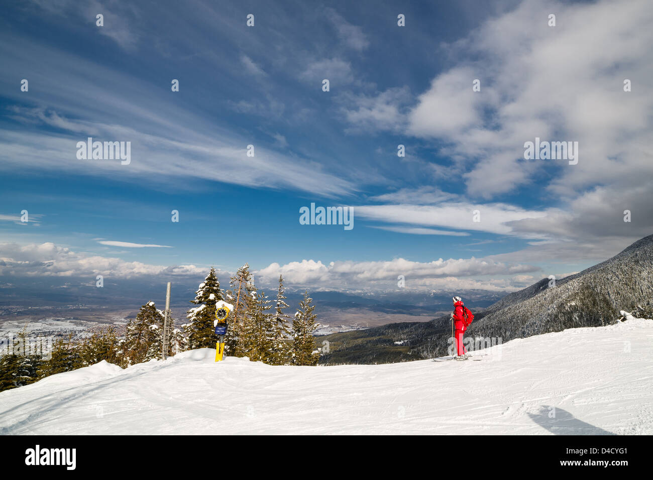 Downhill skiing in sunny frosty winter day - Stock Image