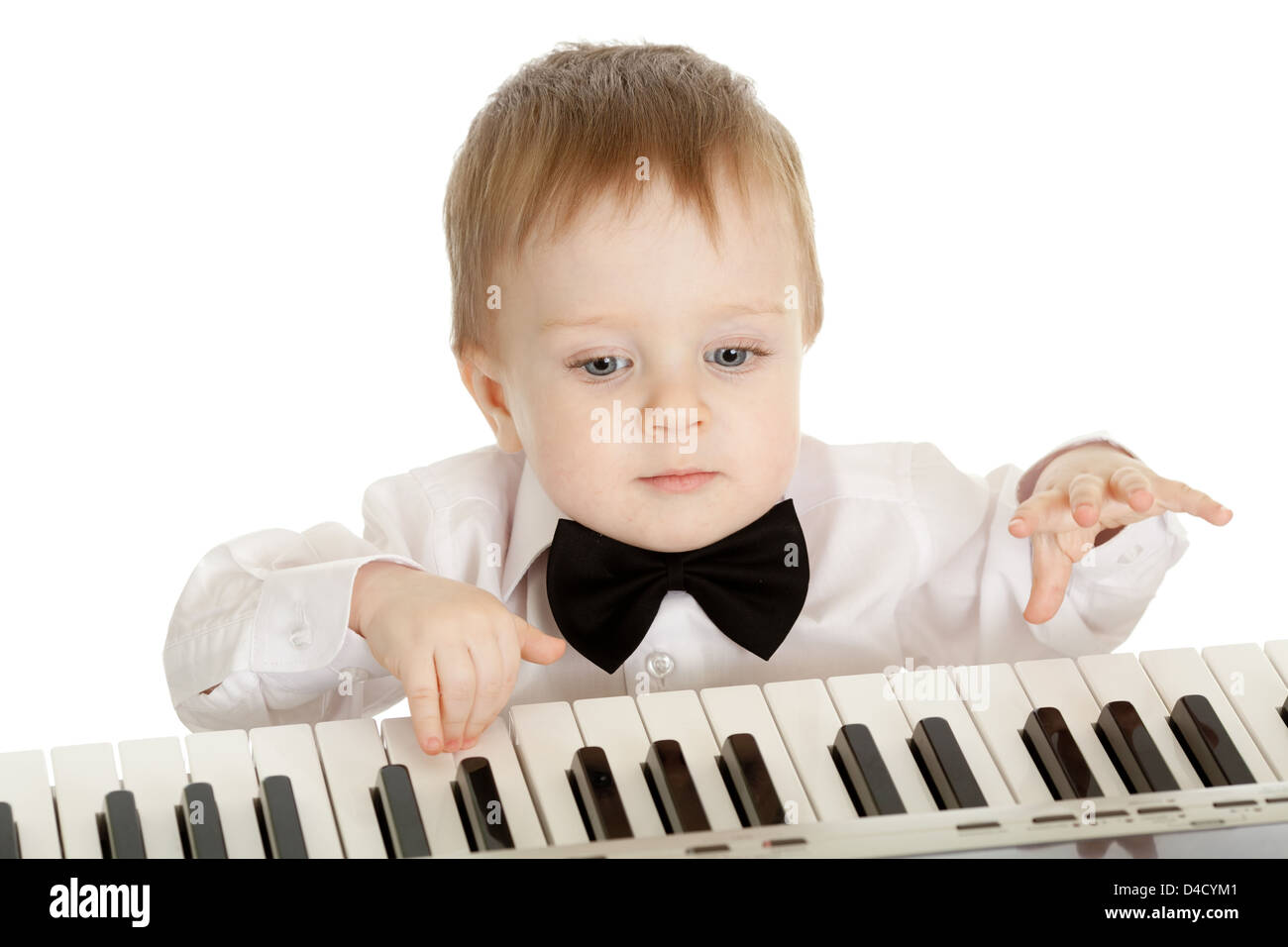 adorable child playing electronic piano - Stock Image