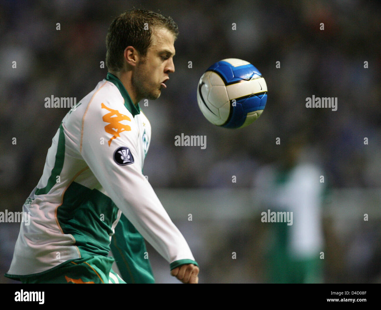 Bremen's Daniel Jensen focusses the ball during the UEFA Cup round of last sixteen first leg match Glasgow Rangers Stock Photo