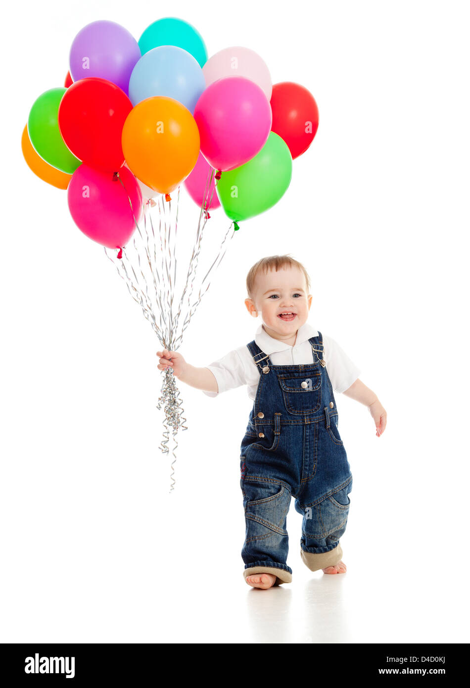 Smiling baby boy with bunch of colorful ballons in his hand. Isolated on white. - Stock Image