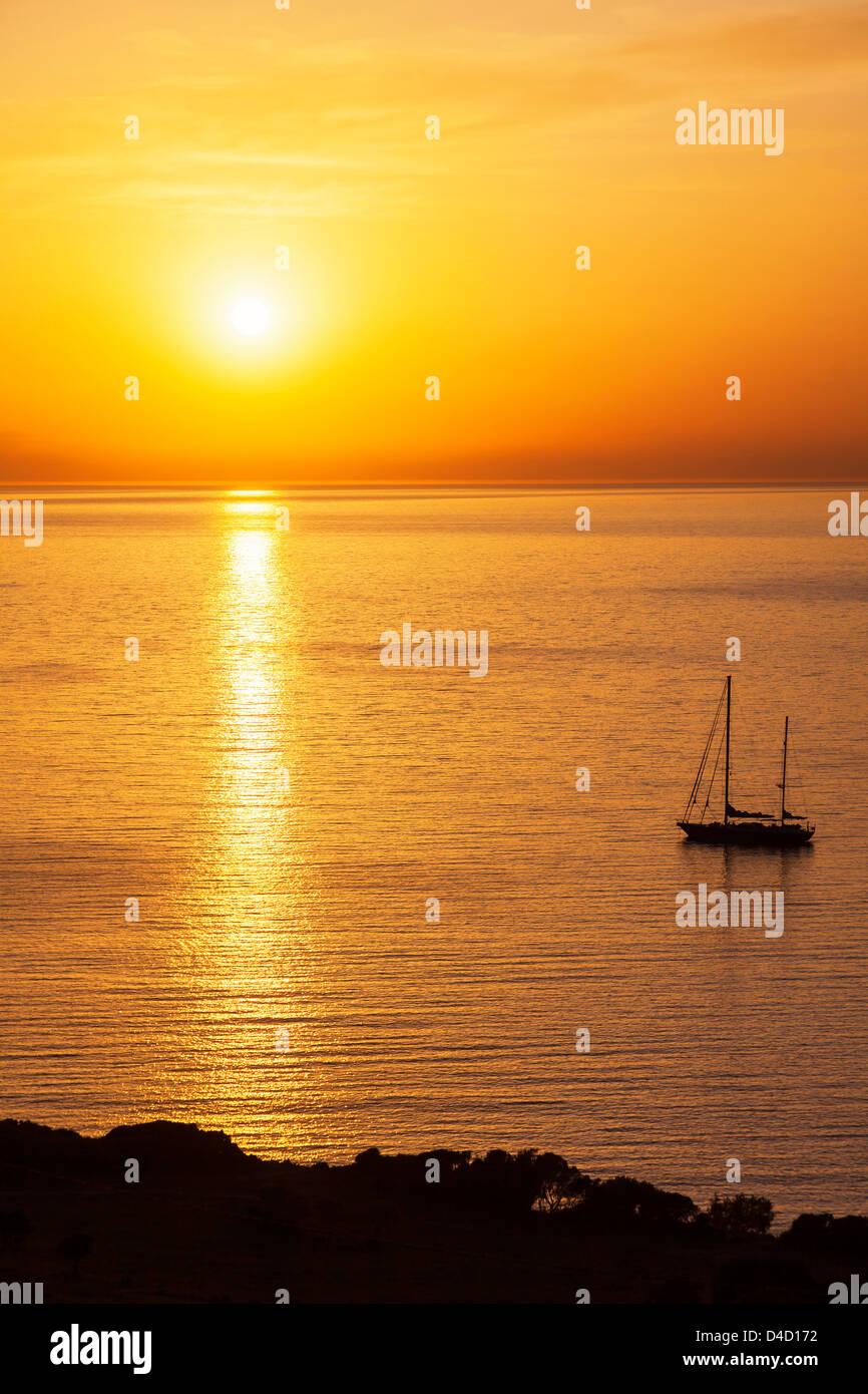 Sunset at a desert bay South of Calvi, Corsica, France - Stock Image