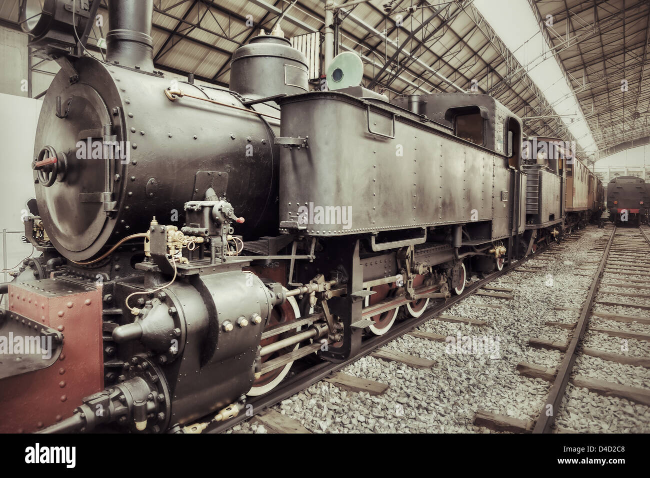 Old retro steam train locomotive in station - Stock Image